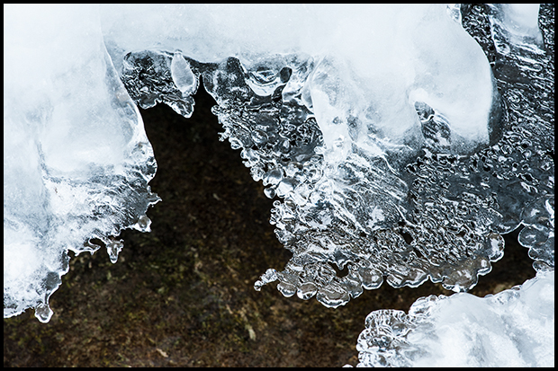 Ice crystal formations at the base of a small waterfall Maligne River