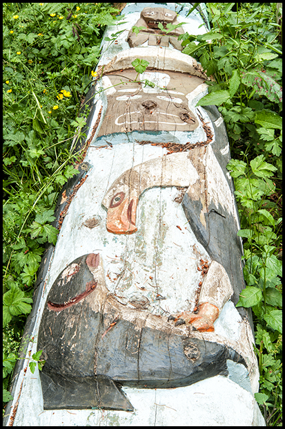 The spiritual carved figures on a totem pole