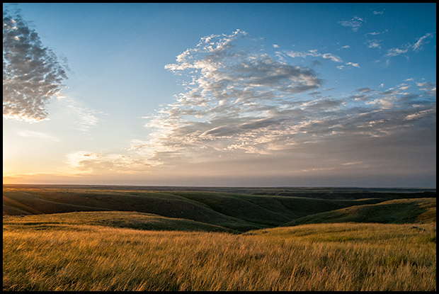 First rays of light skim across the land, Grasslands National Park