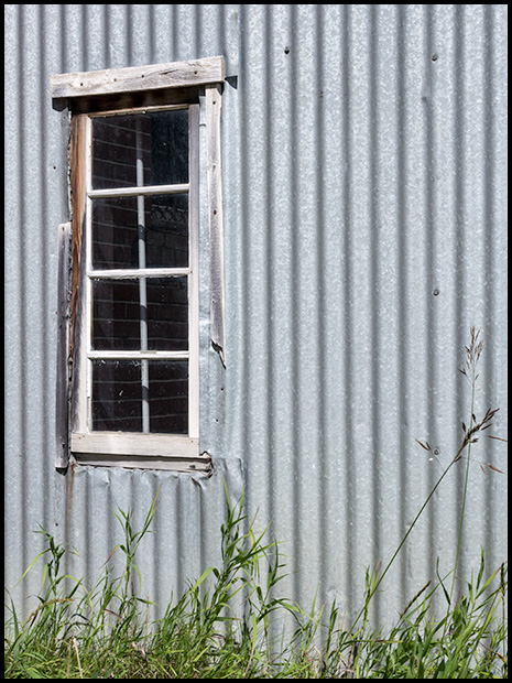 Window and corrugated metal, Olympus OMD E-M5, Olympus 12-50mm f3.5-6.3 ©Leslie Degner