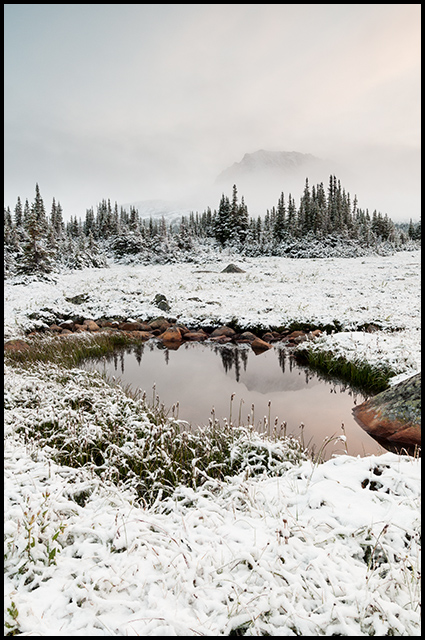 Snowfall and pool of water reflecting Mount Clitheroe, Nikon D300, Nikon 12-24mm f/4, ©Leslie Degner
