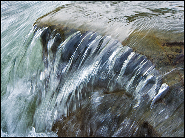 Water flows over rock, Bighorn River, ©Leslie Degner