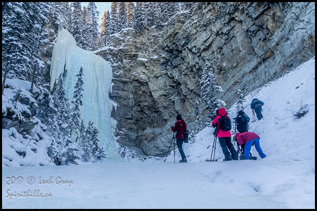 Photographers at frozen waterfall