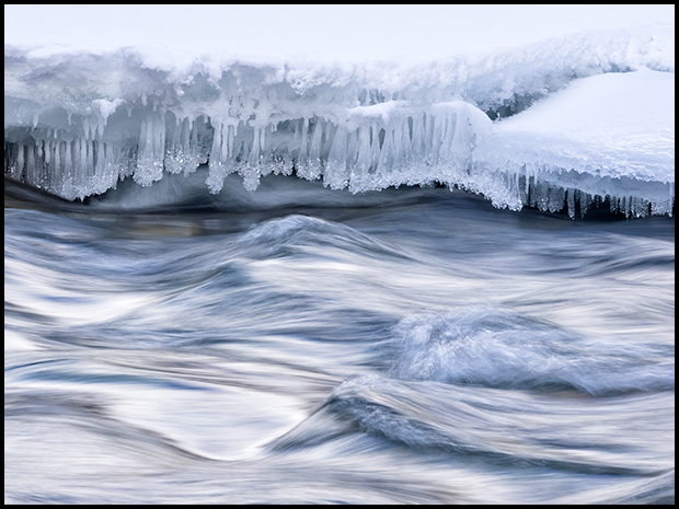 Ice at the edge of the river