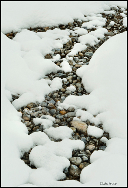 Pebbles and snow, Winter patterns, Banff National Park, Canadian Rockies, Alberta